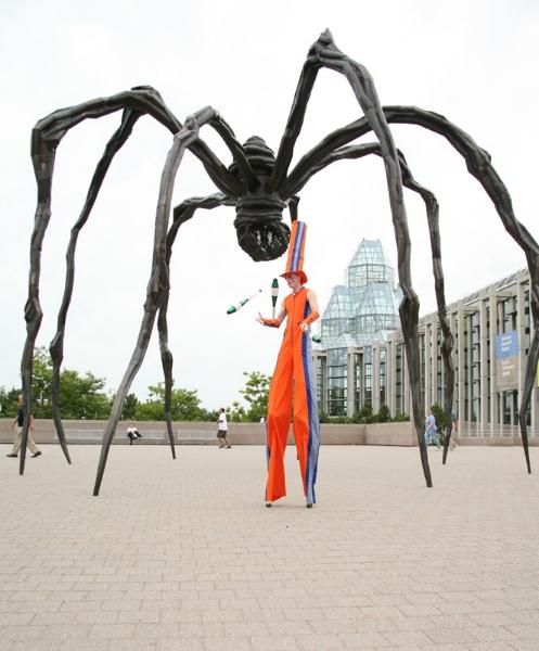 Alain Stilt-Walking and Juggling under the Spider